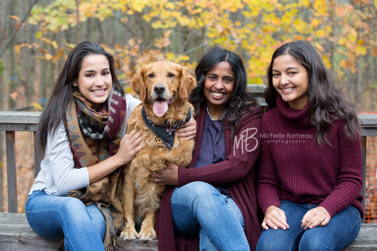 mom with daughters and dog