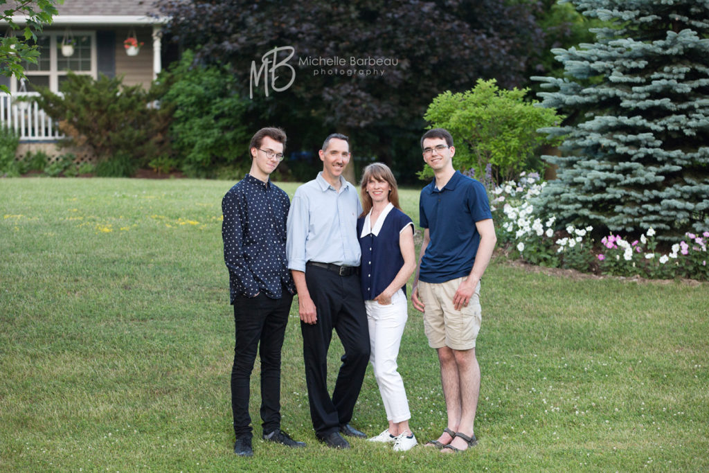 Dunrobin family in front of house